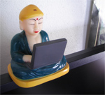 Our squeaky Buddha working on laptop